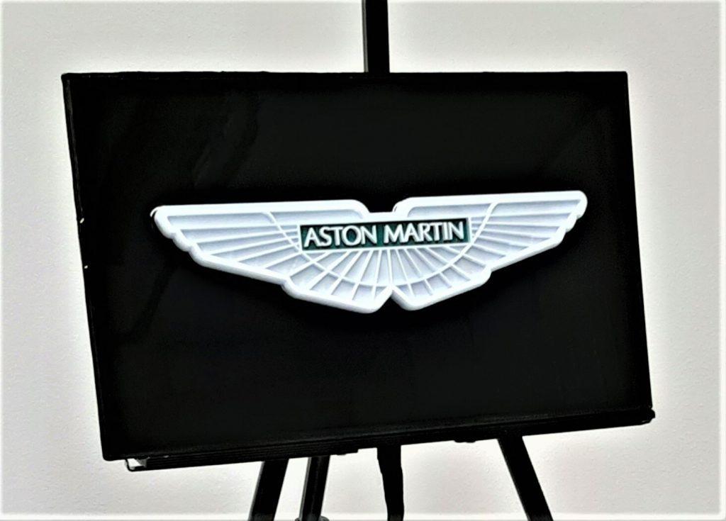 automotive brand crash Aston Martin logo